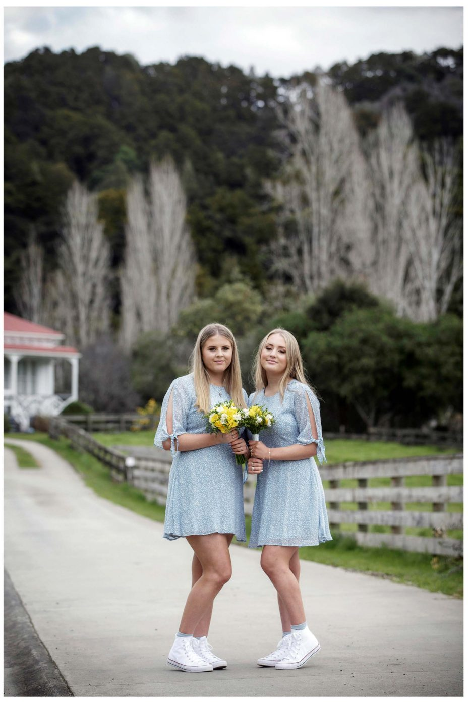 Bridesmaids in blue dresses in Puhoi Village wedding