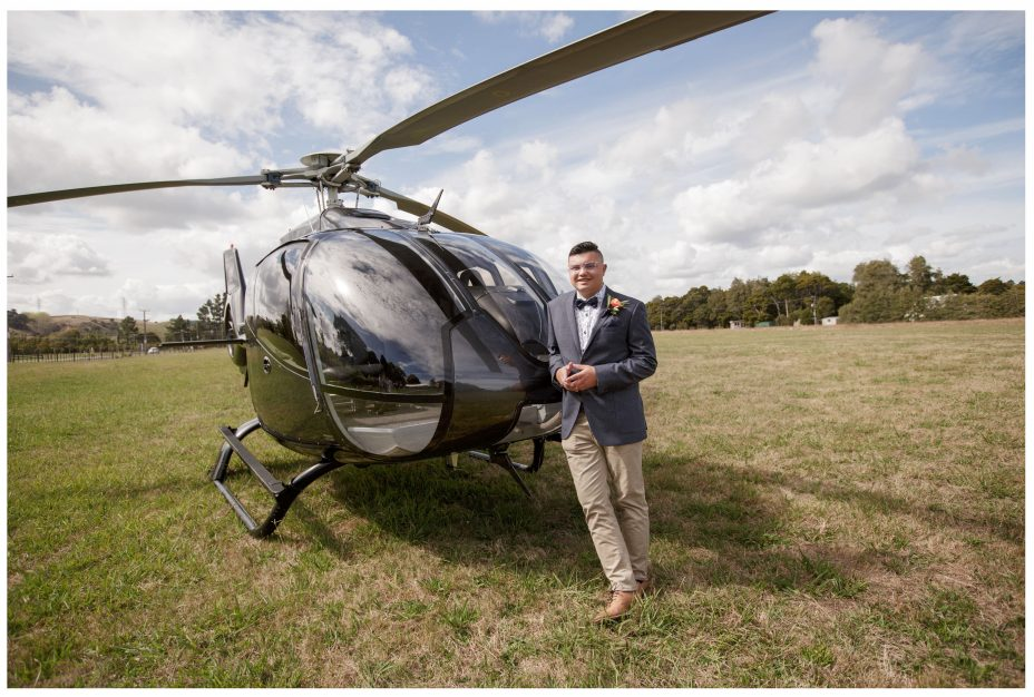 Bride groom posed with the Heletranz helicopter before wedding cermony