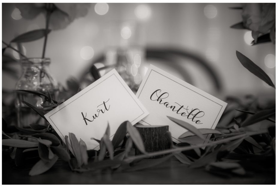 named place cards of bride and groom at wedding reception in The Barn at The Hunting Lodge Winery