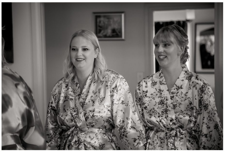 Bride and bridesmaid in their dressing gowns getting ready