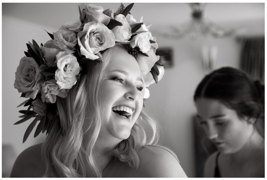 Bride with flower crown laughs