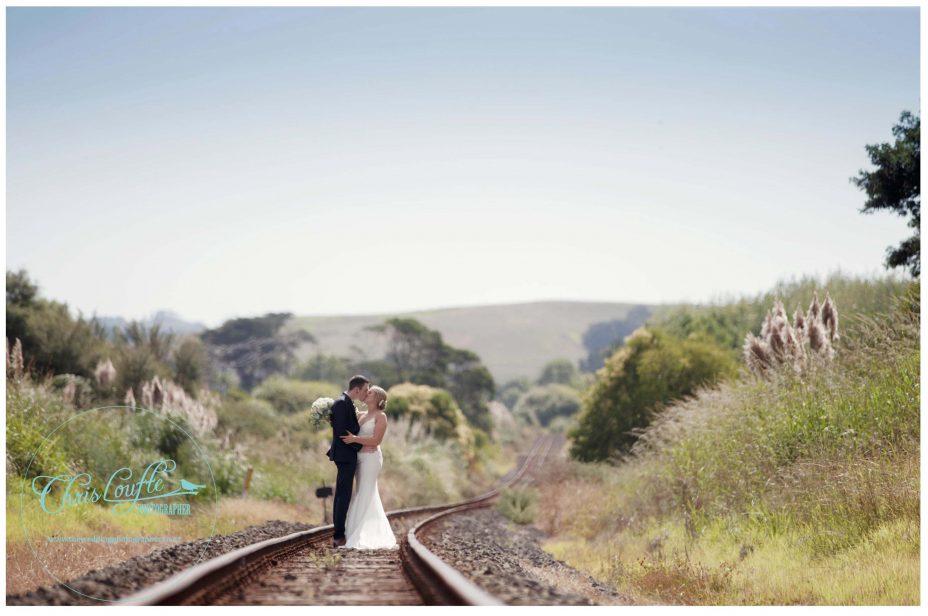 Bride and groom wedding photo on railway line Kumeu Auckland