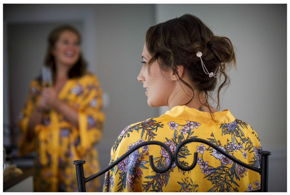 Bridesmaid in gold floral pattern robe, Bridal preparations, Lichfields Cottages Kumeu