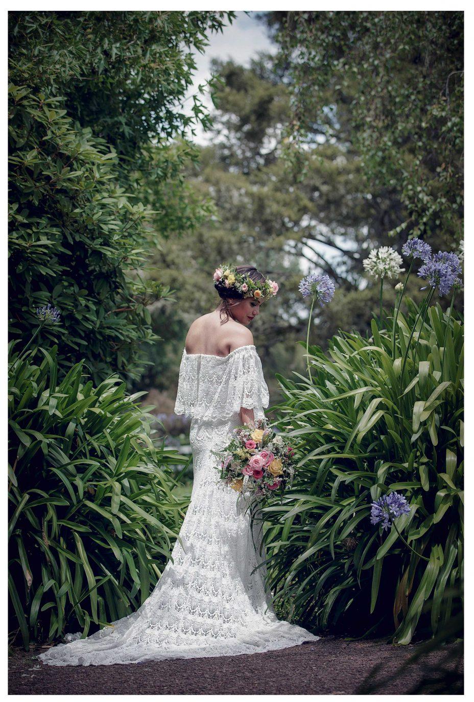 Bride in lacetop wedding dress in Kumeu garden, Lichfield's Cottages