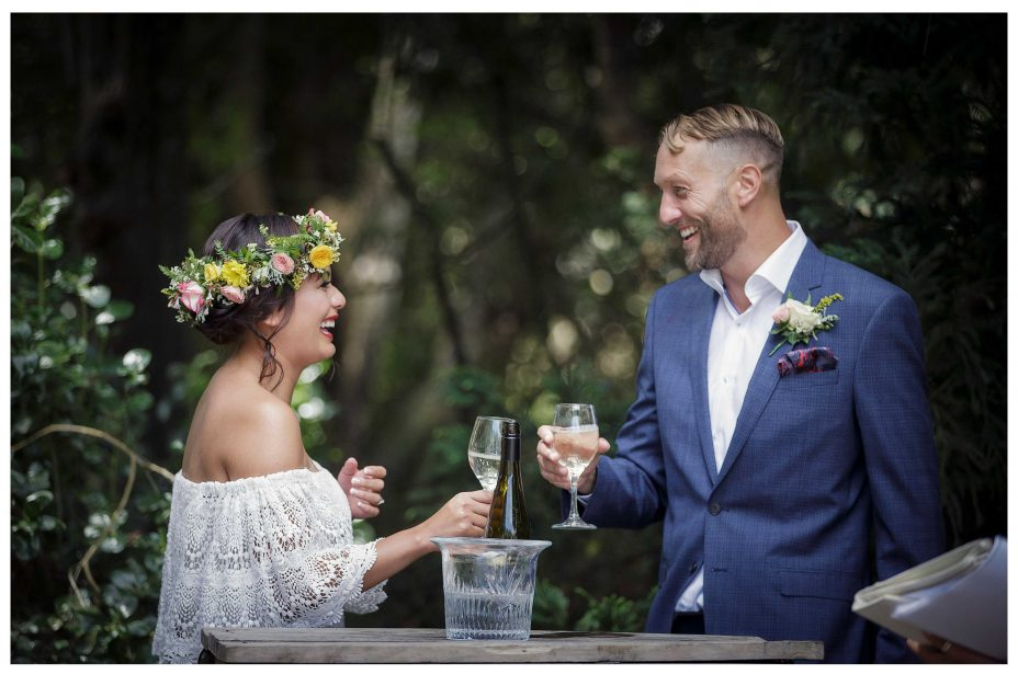 Kuemu Valley Estate garden wedding, Bride and groom share a glass of wine