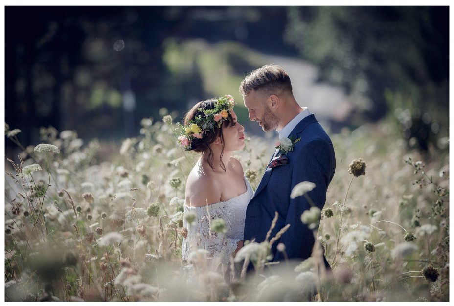 Bride and groom romantic photo in long grass Kumeu wedding