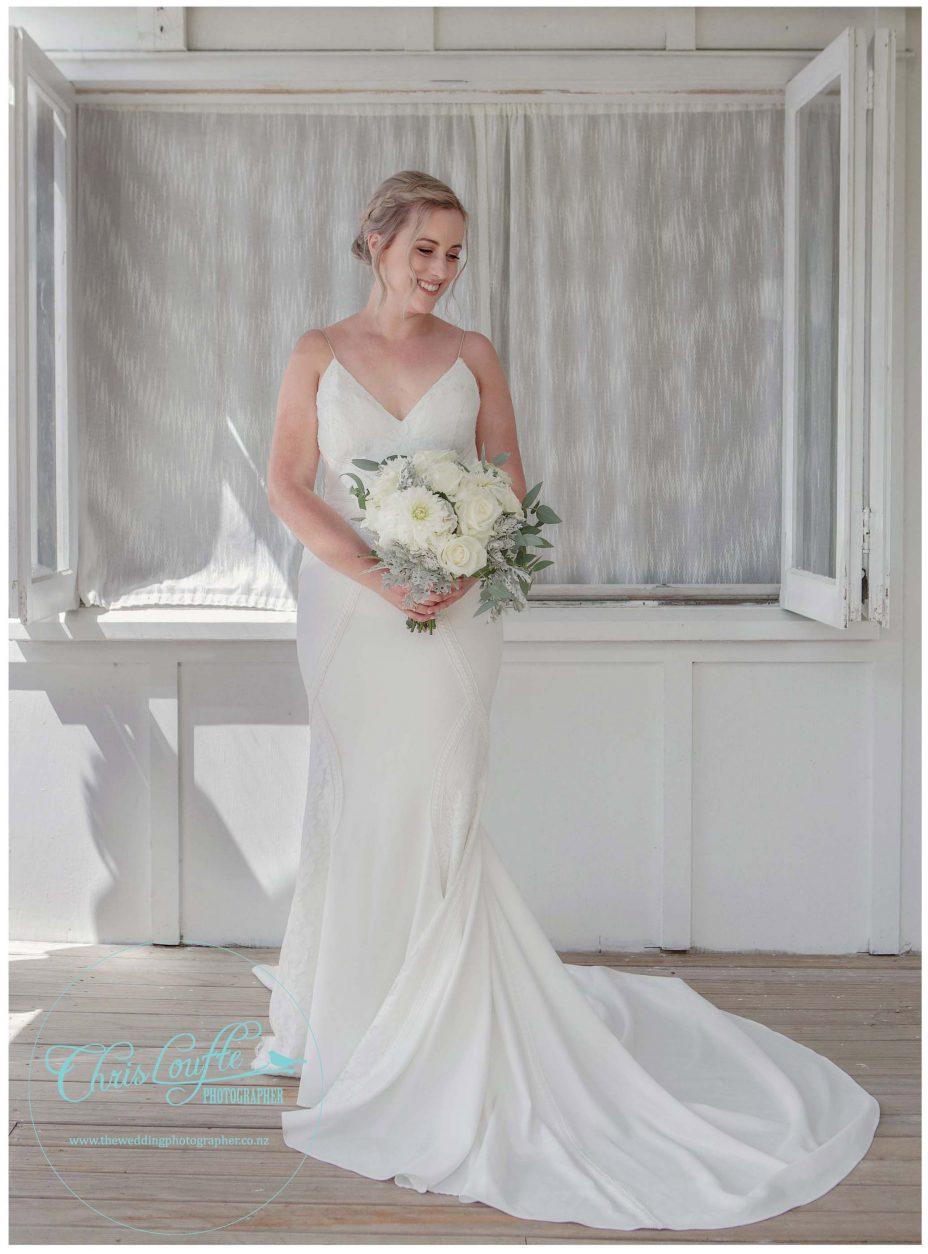 Bride in ivory backless wedding dress, wedding bouquet flowers