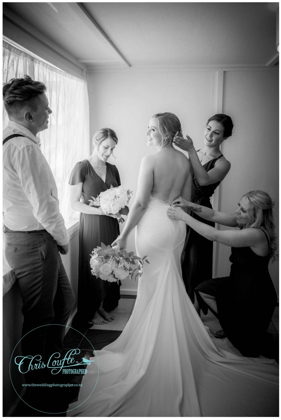 Bride and bridesmaids dressing, black and white photo