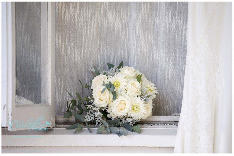 Wedding dress, bridal bouquet cream roses