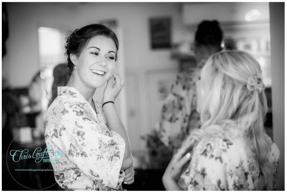 bridesmaid in robe puts on jewellery , Kumeu wedding