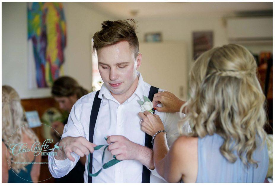 Bridesman puts on bow tie , Kumeu wedding