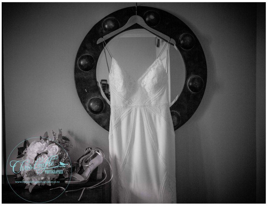 Ivory Wedding dress hangs from vintage round mirror , Kumeyu wedding