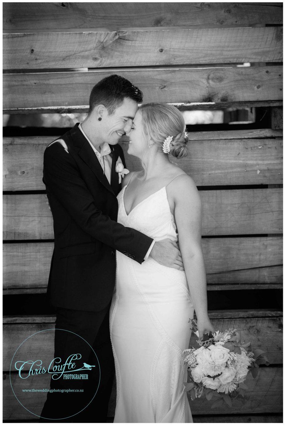 Bride and groom together in Orchard, Kumeu Wedding