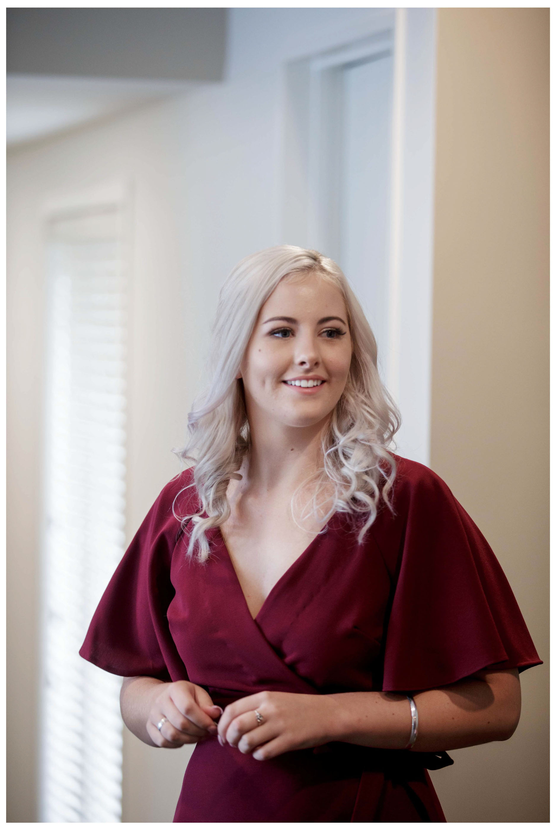 Bridesmaid in wine coloured dress beauty shot