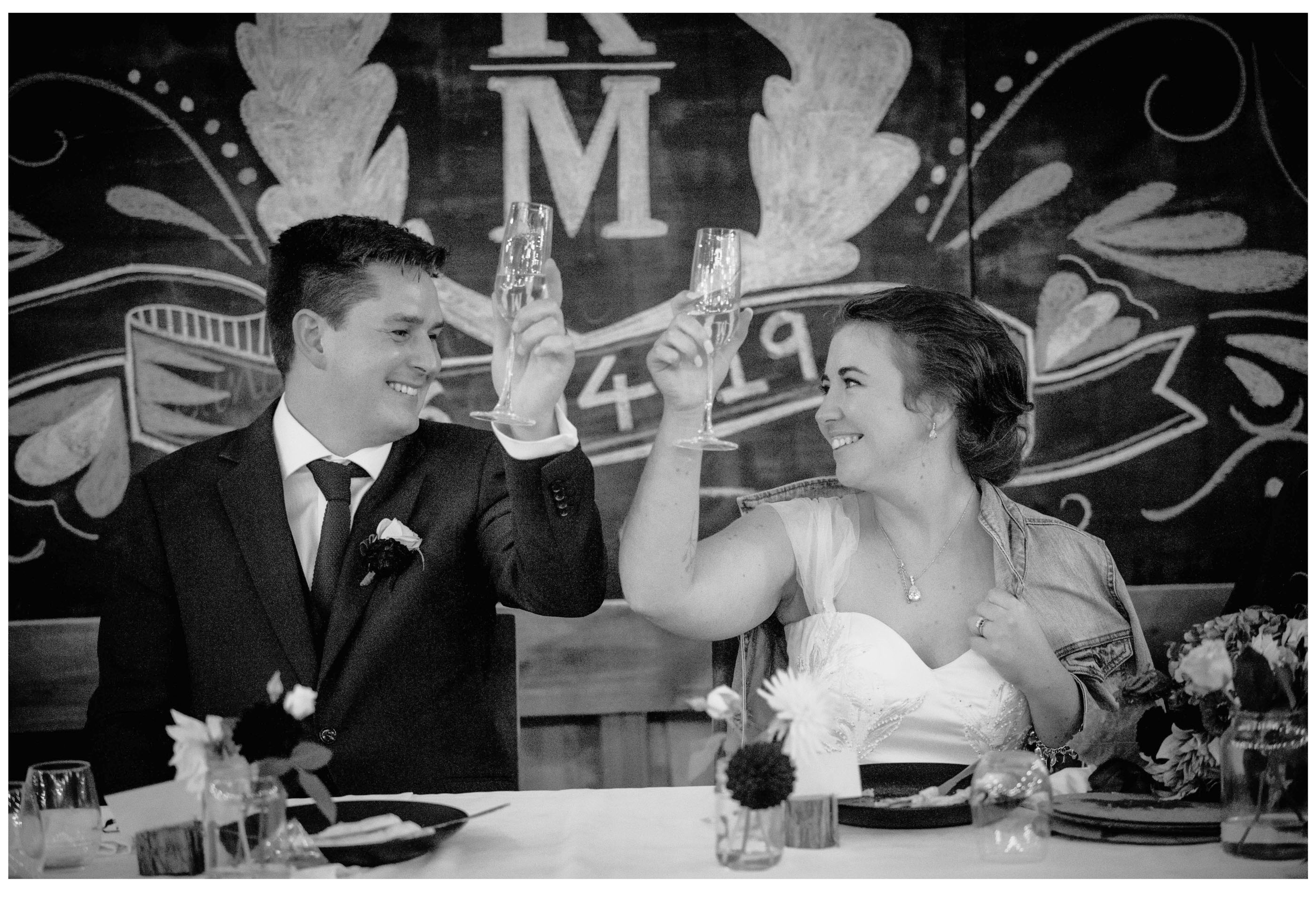 Bride and groom make romantic champagne toast