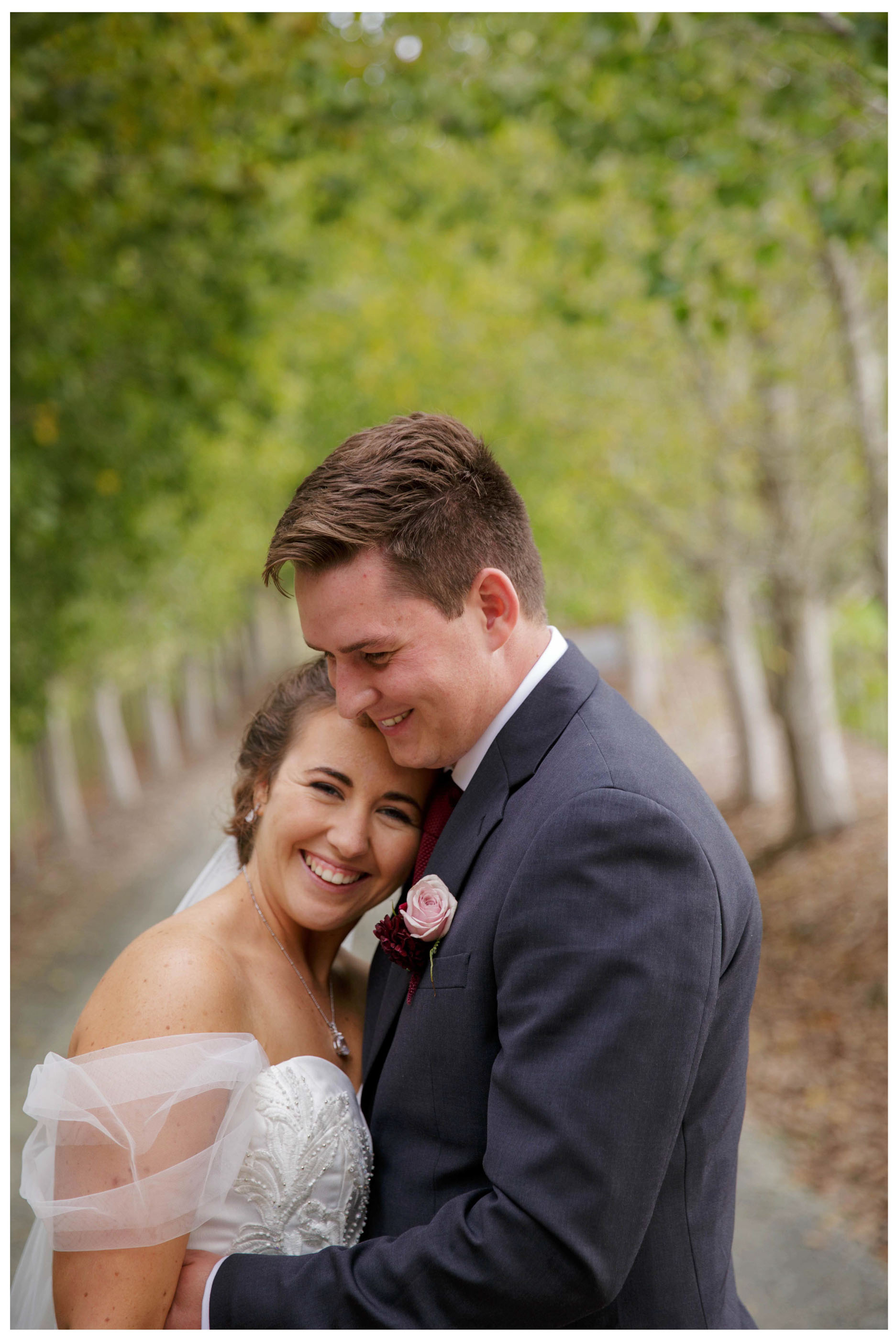 Bride and groom loving happy photo outdoors at Kumeu wedding