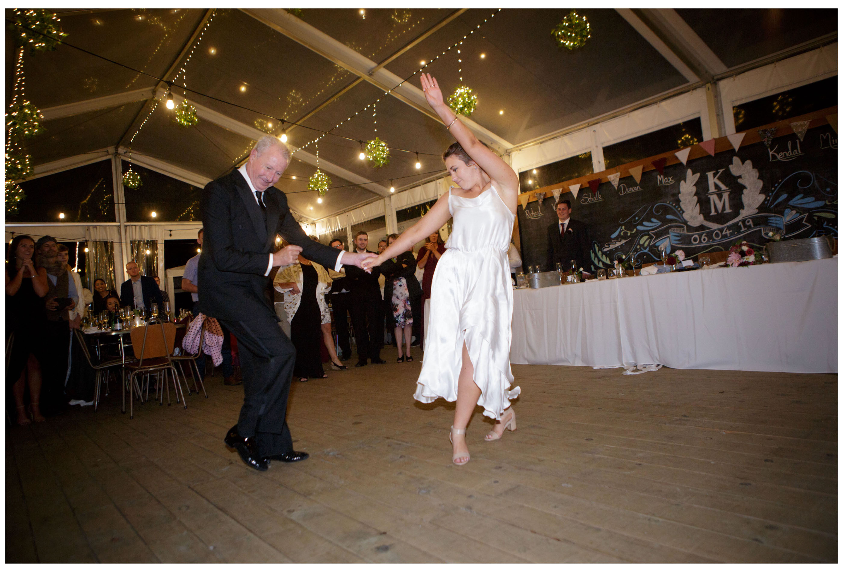 Father and bride dance in marquee wedding reception in Kumeu Auckalnd