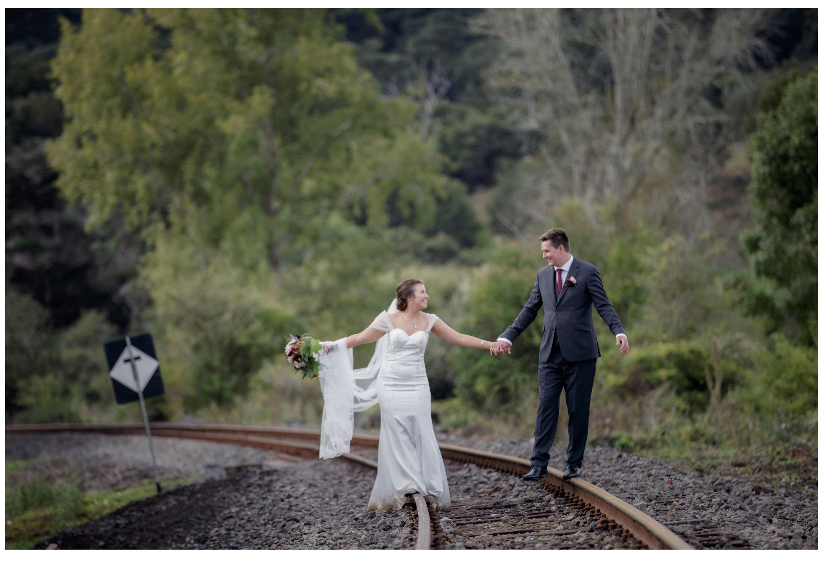 Bride and Groom creative wedding photo on Kumeu Railway line