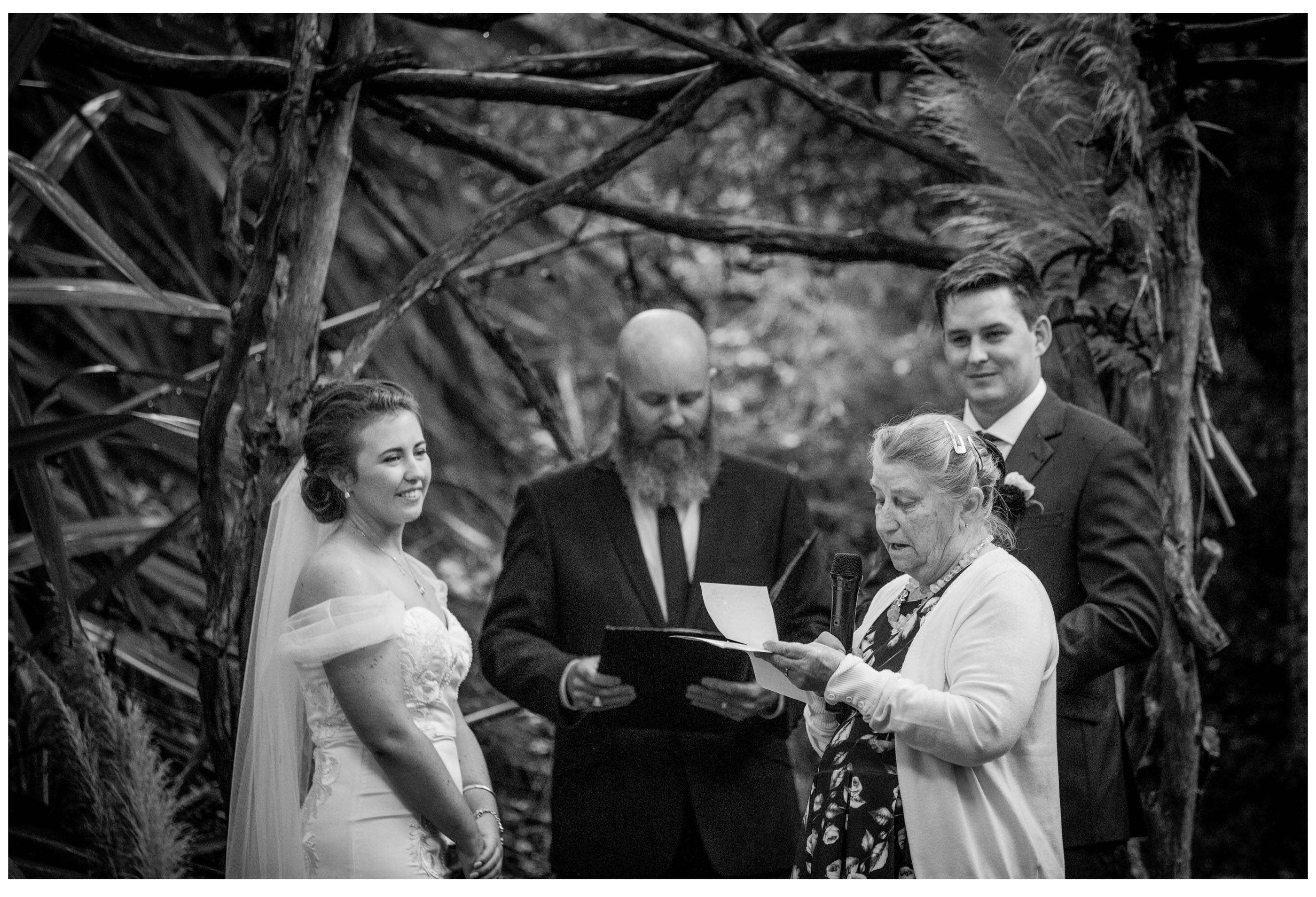 Nana reads poem at outdoor woodland wedding ceremony in kumeu