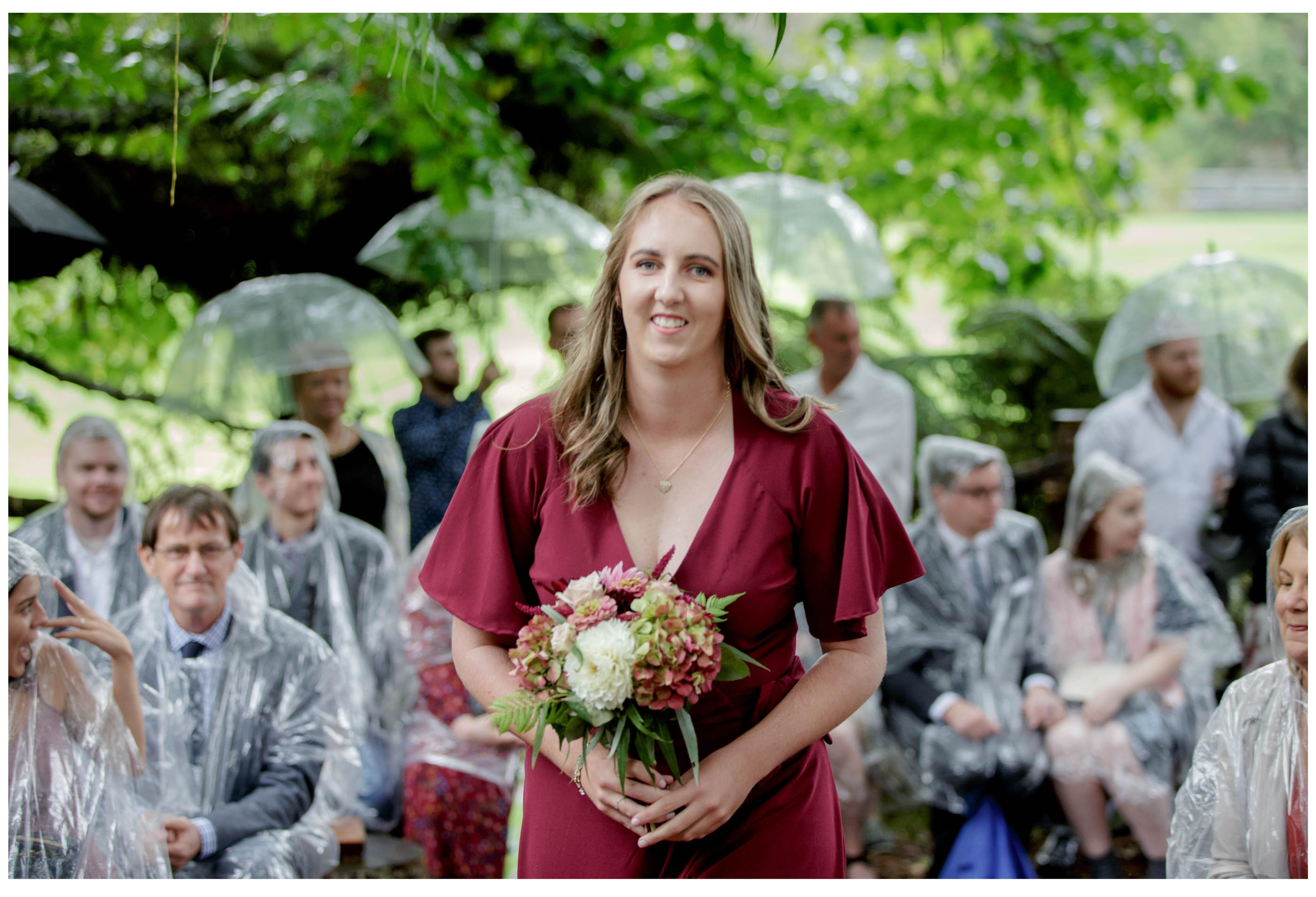 Bridesmaid walks down woodland weding ceremony Isle