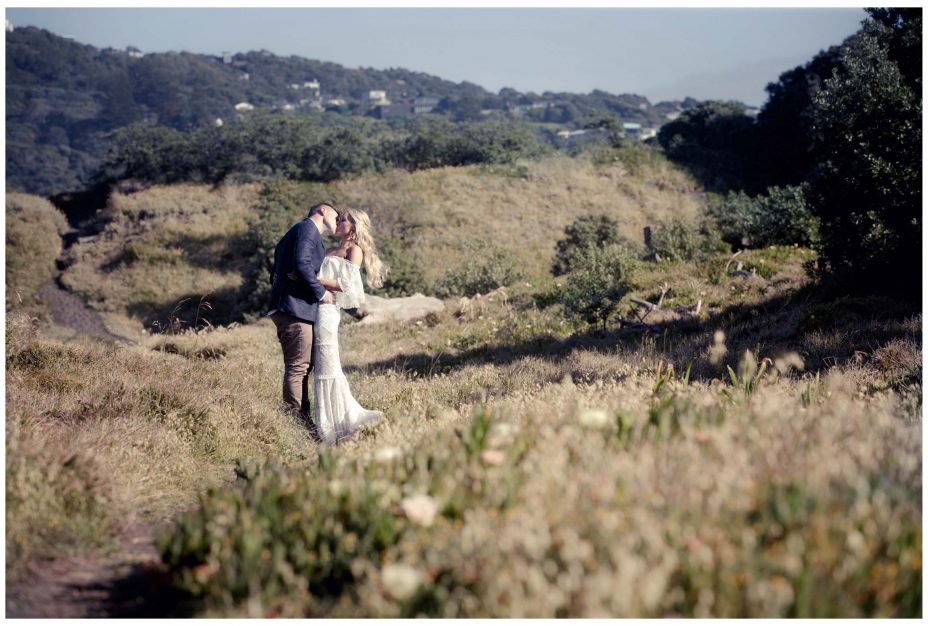 Australian Bride and groom in sand dunes Murawai Beech, Murawai Beech Wedding photo
