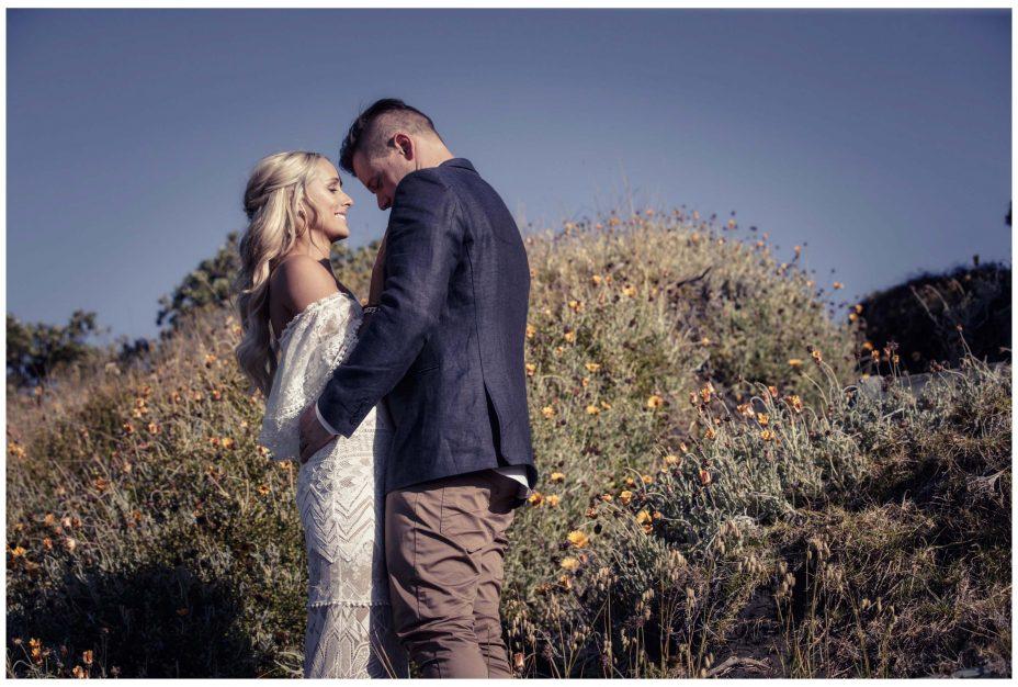 Bride and groom romatic photo in Murawai Beech sand Dunes.