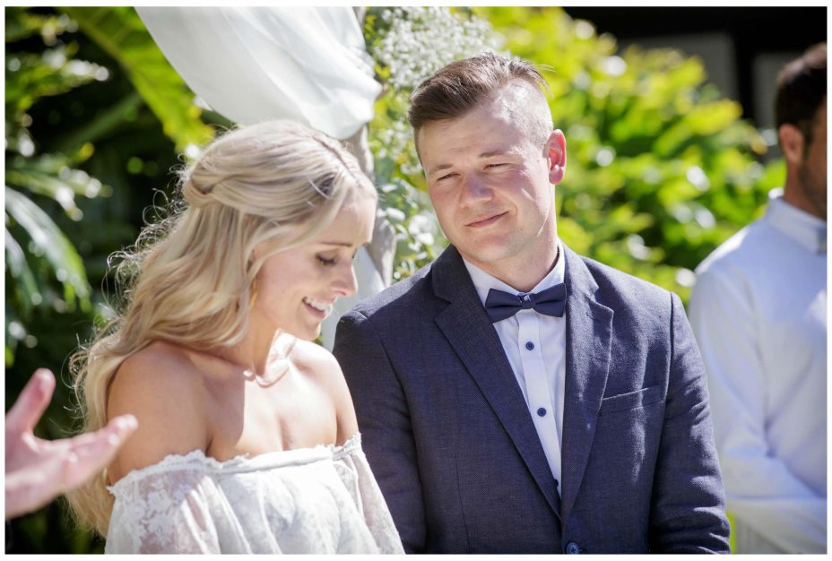 Groom looks lovingly at aussie bride during Auckland wedding ceremony