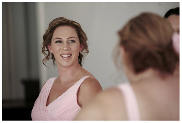 Bridesmaids in pink pleated dress get ready for a wedding at Gracehill Vineyard Estate.