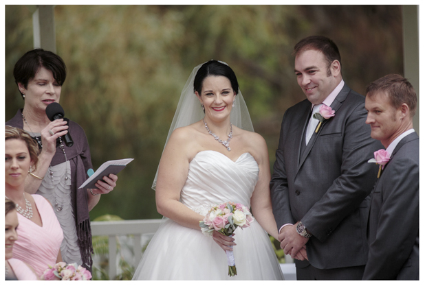 Bride and groom laugh joyfully during wedding ceremony at Gracehill Vineyard Estate
