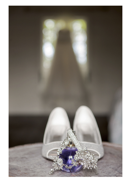 close up photo of wedding shoes and perfume