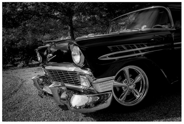 Black and white photo of classic American wedding car.