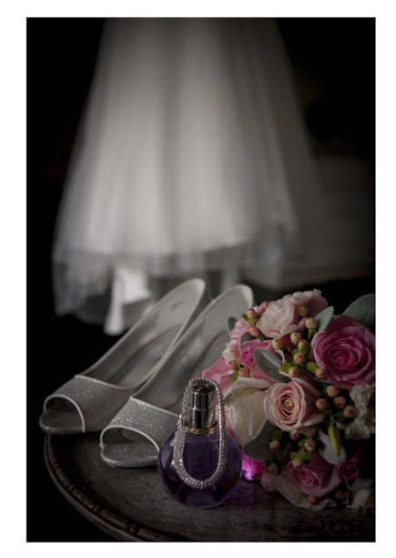 colourful Bridal floral bouquet photo with wedding dress and shoes.