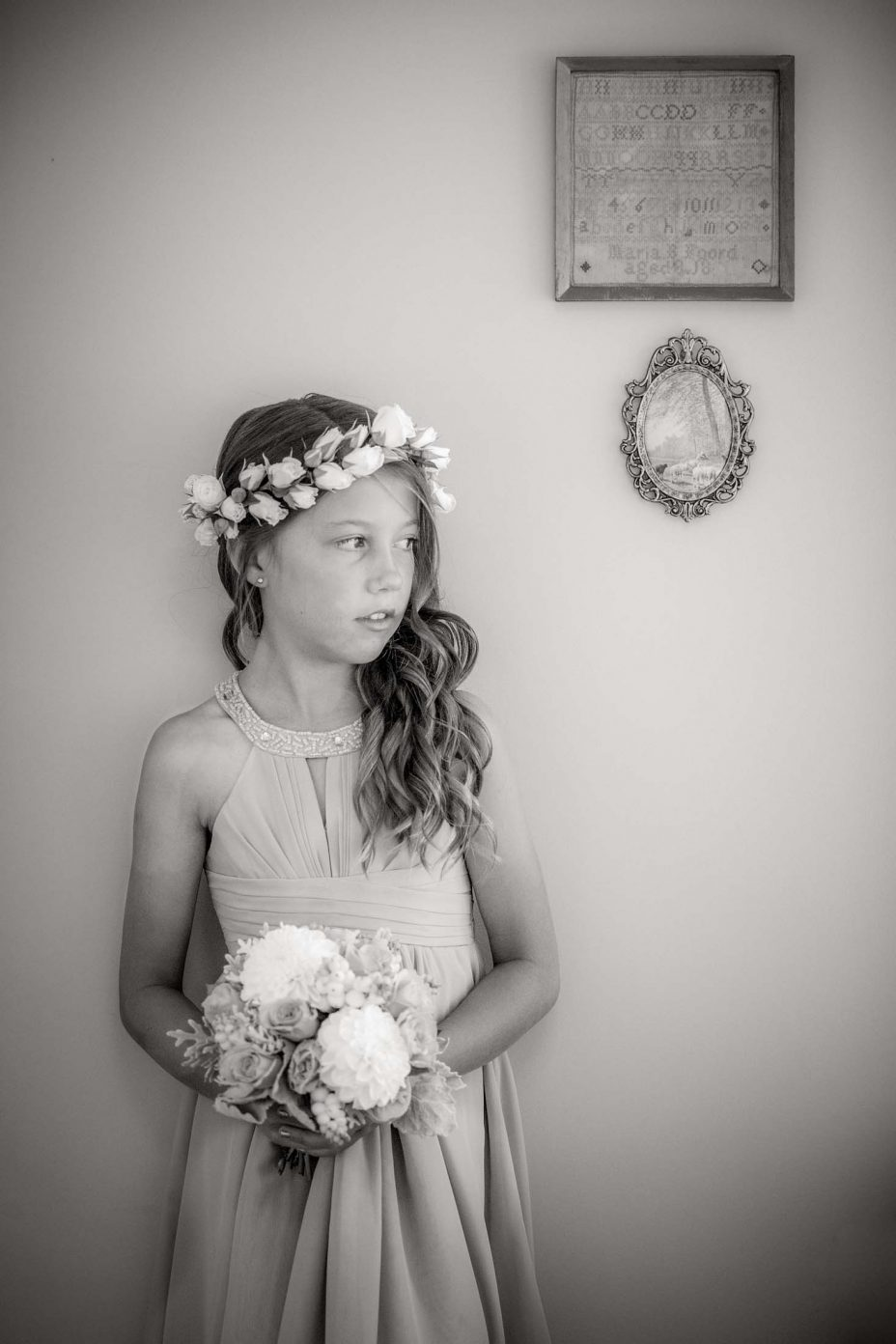 Bridesmaid girl in pink dress poses at wedding. Black and white photo