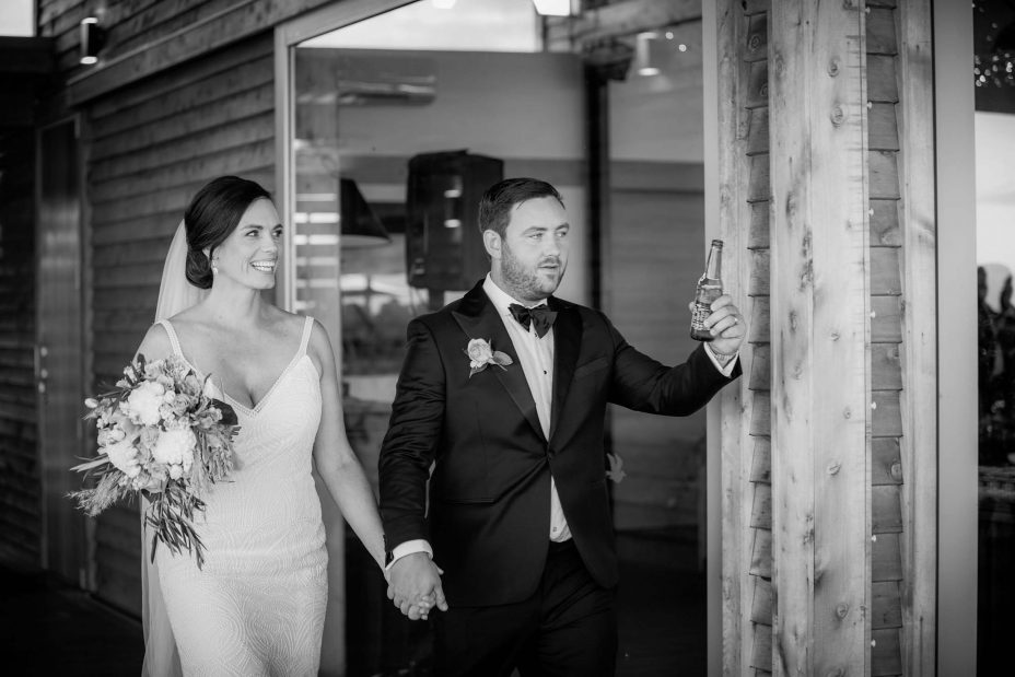 Bride and groom enter their wedding reception at KBB Kauri Bay Boomrock