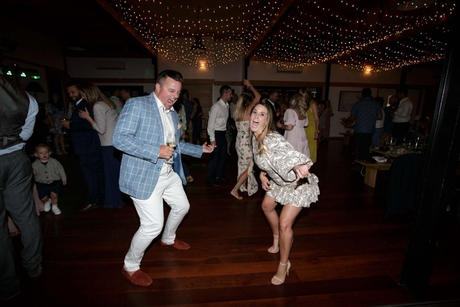Capturing the moment.Fun couple energetic dancing at wedding reception