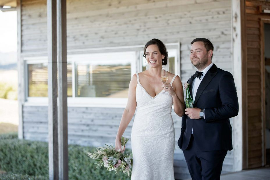 Bride and groom laugh at speeches during their wedding reception at KBB Kauri Bay Boomrock