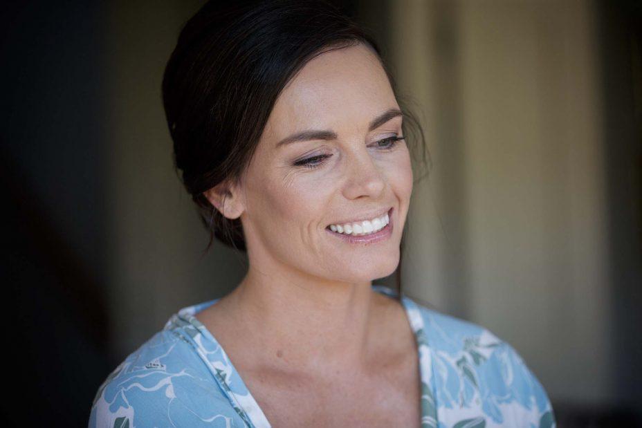 Bride in blue robe smiles