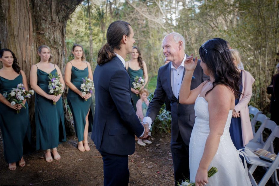 Bride's father greats groom at wedding ceremony
