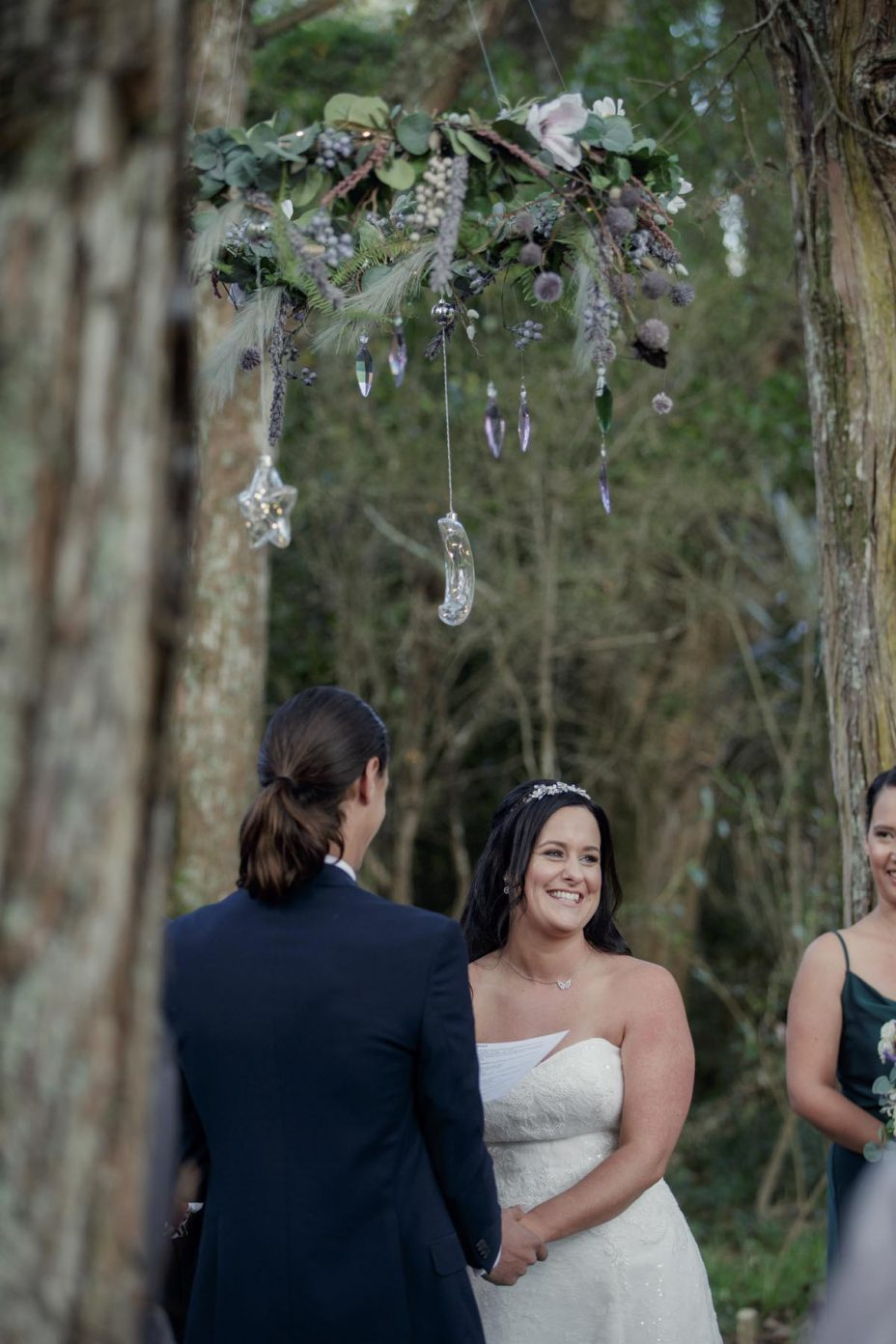Bride and groom make their wedding vows during ceremony at Kumeu Valley Estate