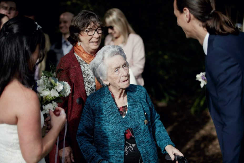 Grandmother congratulate bride and groom after wedding ceremony
