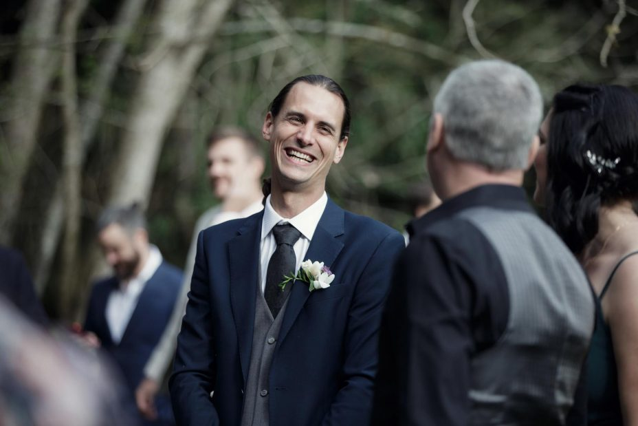 Groom smiles very happy after wedding ceremony Kumeu Valley Estate