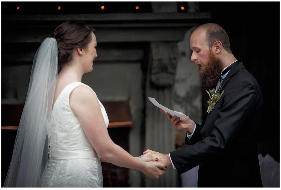 Bride and groom look into each other's eyes and exchange wedding vows during their wedding ceremony at Mantells Mount Eden.