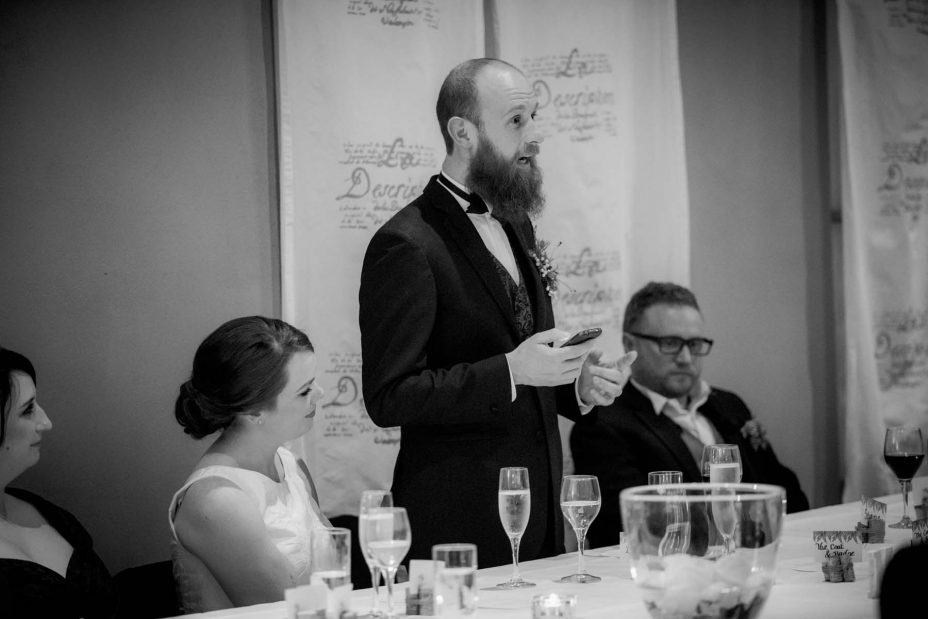 Groom makes his speech during his wedding reception at Mantells in Mount Eden.