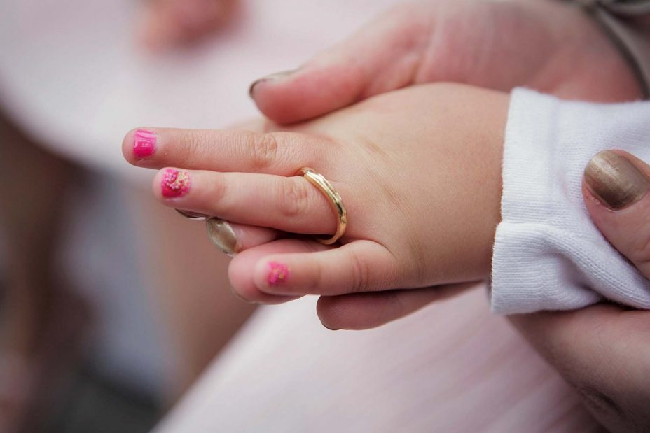 Close up of flower-girl's hand wearing the brides wedding ring during the ceremony at Mantells in Mount Eden.