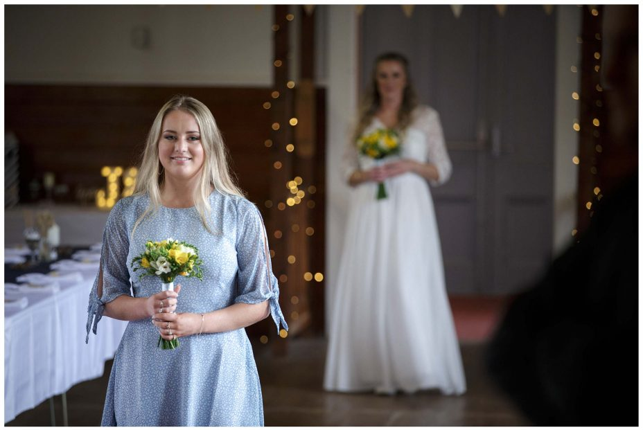 Bridesmaid in blue dress at Puhoi Village Hall