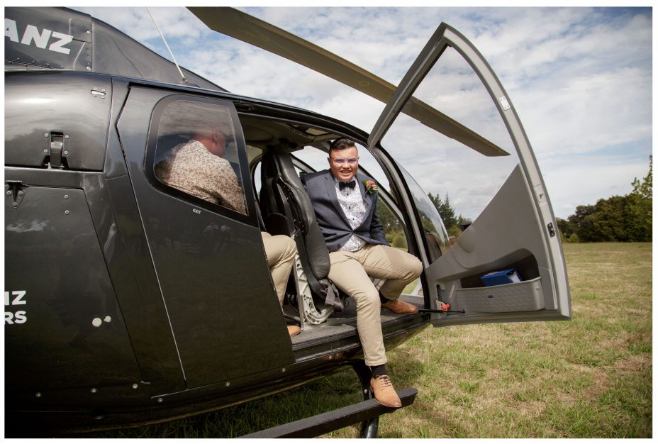 Groom arrives to The Hunting Lodge Winery Auckland by helicopter.