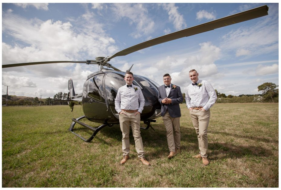 Groom and groomsmen with Heletranz helicopter they flew into The Hnting Lodge Winery t