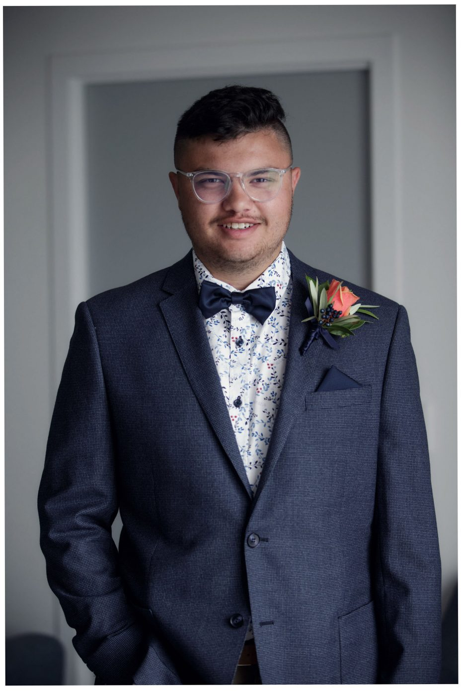 Bridegroom dressed in suit and bow tie ready to go.