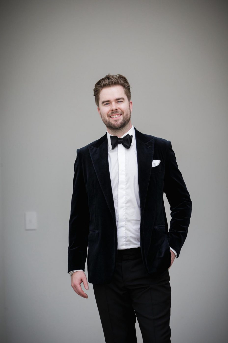 Black and white photo of groom in bow tie and dinner jacket at Northern Club Auckland.