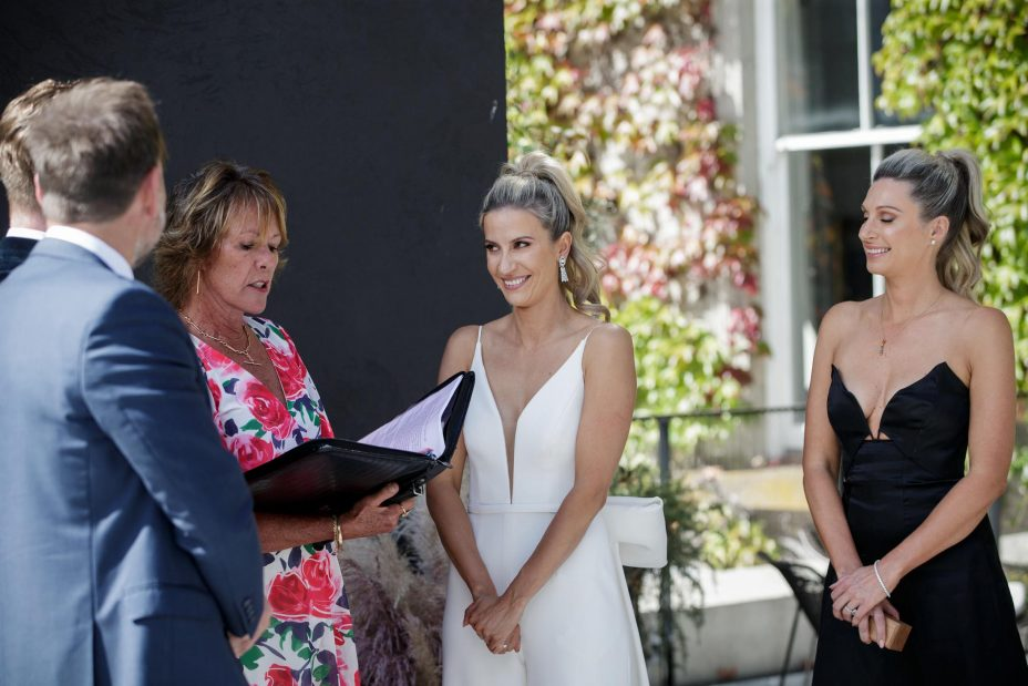 Bride and groom exchange vows and rings at the Northern Club Auckland